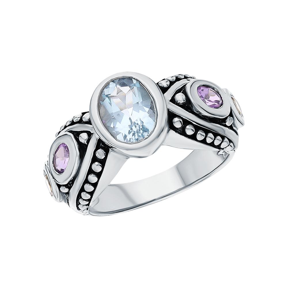 Фото «Серебряное кольцо с аметистом, топазами и цитринами»