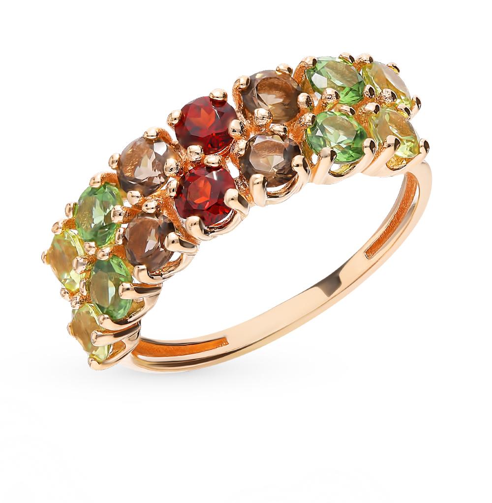 Золотое кольцо с раухтопазами и гранатом в Санкт-Петербурге
