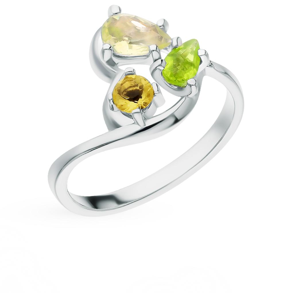 Фото «Серебряное кольцо с хризолитом, фианитами и цитринами»