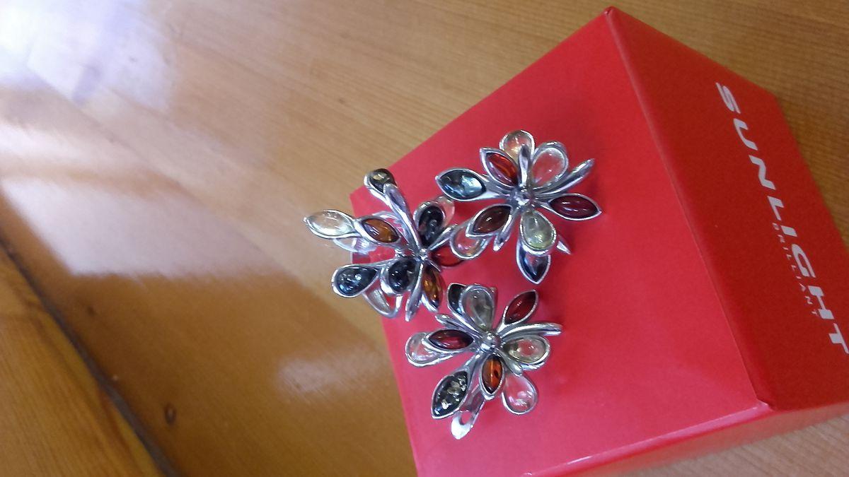 Необычное кольцо. Янтарь всех цветов.