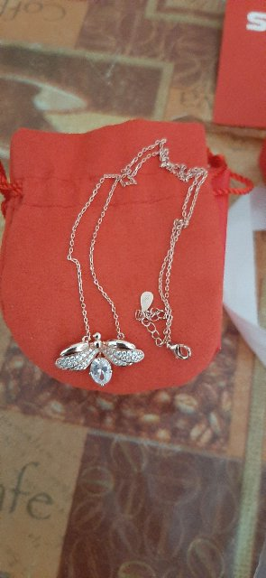 Серебряное шнйное украшение с фианитами