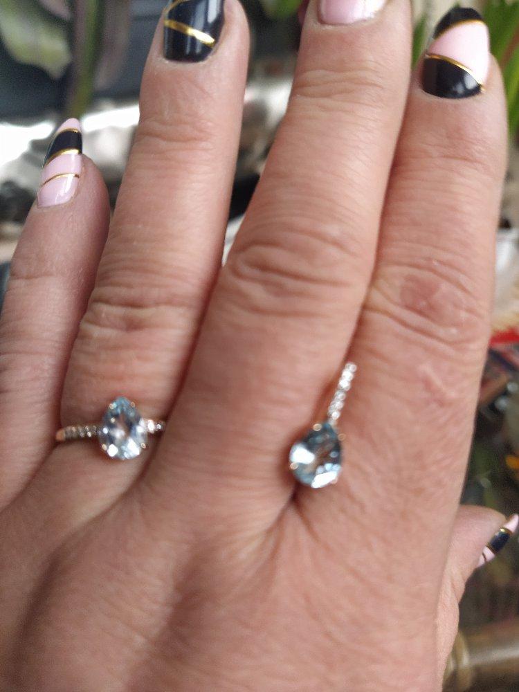 Золотое кольцо с бриллиантом и топазом