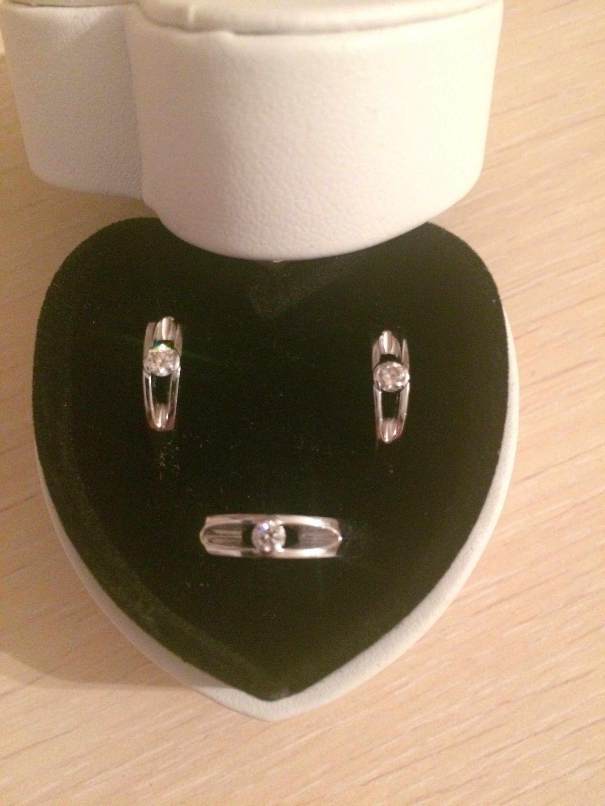 Кольцо с бриллиантом и серьги